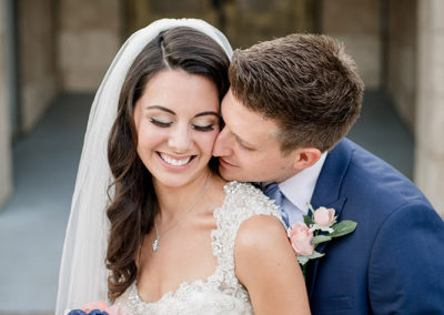Bridal makeup client Bailey with her husband Dino. Bailey's makeup is on point thanks to Jill's makeup artist skills! Photo by Austin Wedding Photography.