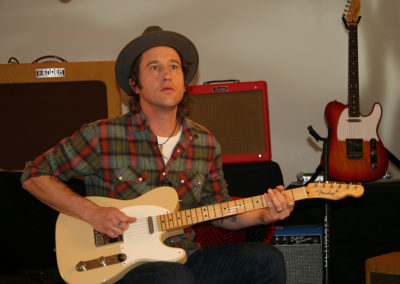 Chris Shiflett of the Foo Fighters  on set for a promotional photoshoot for Fender guitars. Makeup done by Jill!