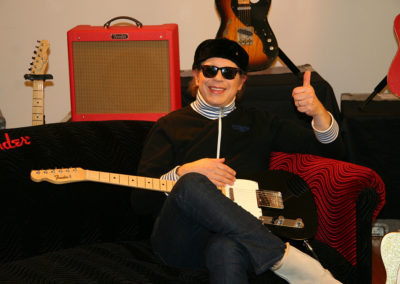 Elliott Eason of the Cars  on set for a promotional photoshoot for Fender guitars. Makeup done by Jill!