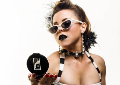 Burlesque Performer Roxy Moxie showing off her Just Jill compact.